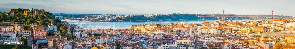 Lisbon sunrise panoramic view across city landmarks to bridge Portugal stock photo