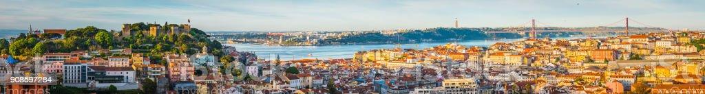Lisbon sunrise super panorama across Castelo Baixa and bridge Portugal - Zbiór zdjęć royalty-free (Alfama)