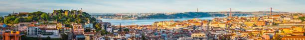 lisbon sunrise super panorama across castelo baixa and bridge portugal - lisbona foto e immagini stock