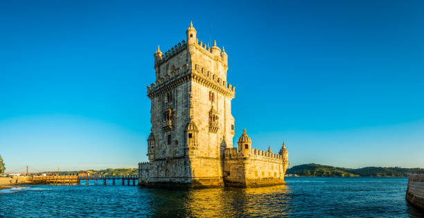 Lisbon Torre de Belem iconic medieval harbour tower panorama Portugal stock photo
