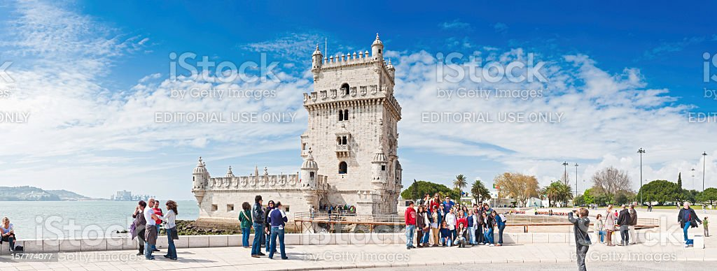 Lisbon tourists at the Belém Tower River Targus Portugal panorama stock photo