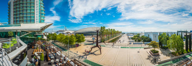 lisbon tourists enjoying waterfront restaurants parque das nacoes panorama portugal - esplanada portugal imagens e fotografias de stock
