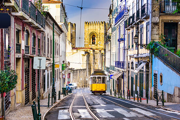 lisbon tram and cityscape - portugal stock photos and pictures