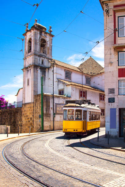 lisbon tram on urban tramway network. alfama district route. portugal - lisbona foto e immagini stock