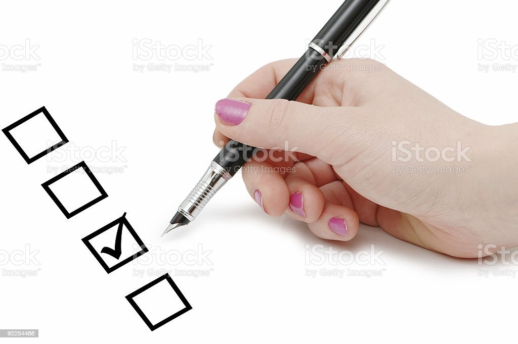 List of checkboxes and hand with pen royalty-free stock photo