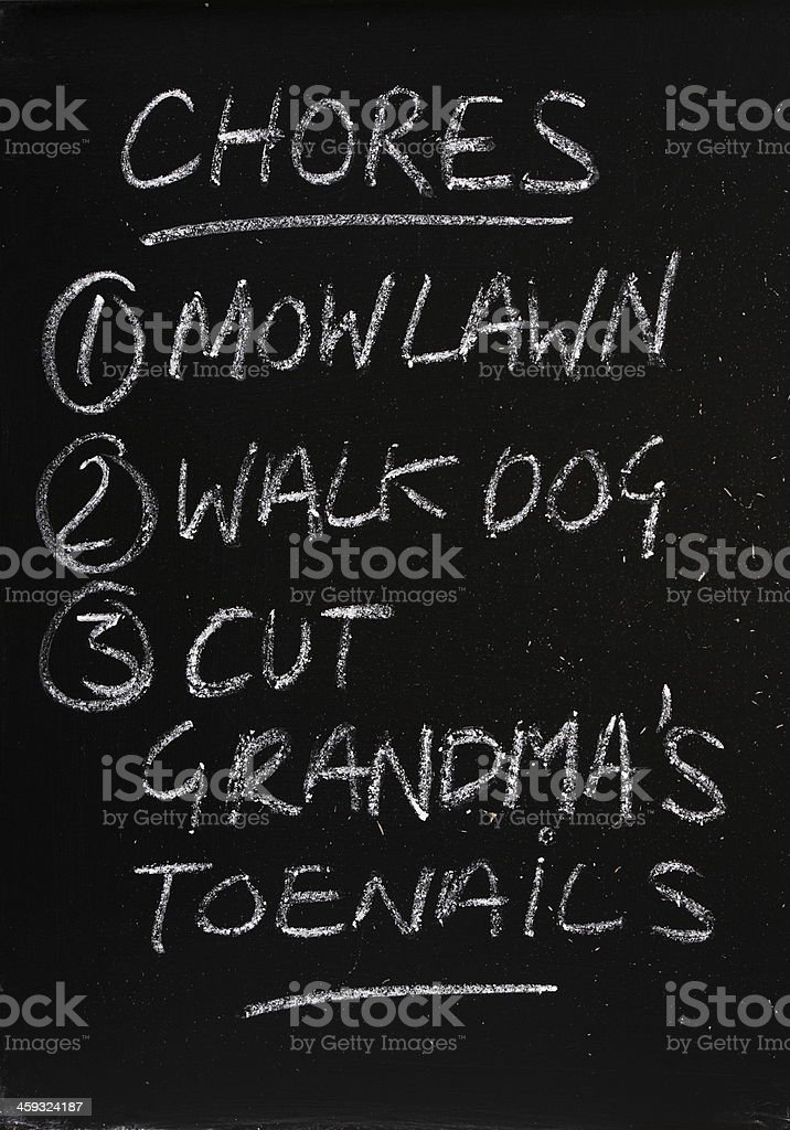List Of Chores on a Blackboard stock photo