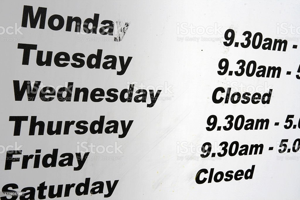 List of opening times stock photo
