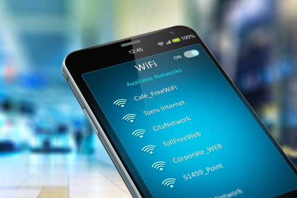 list of wifi networks on smartphone in the shopping mall - беспроводные технологии стоковые фото и изображения
