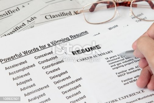 Powerful word for winning a resume concept with classified ads.