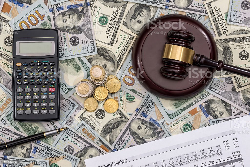list personal budget 2017 money and calculator pen stock photo