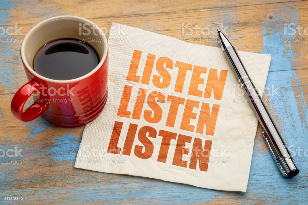 Listen concept on napkin - foto de stock