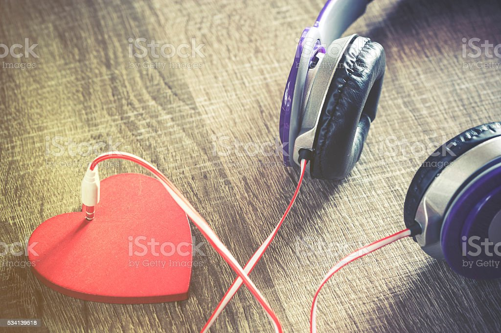 Listen to your heart. Love music concept stock photo