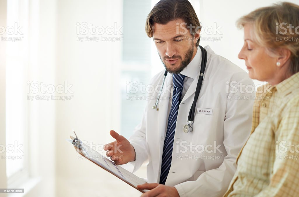 Listening carefully to her doctor's advice stock photo