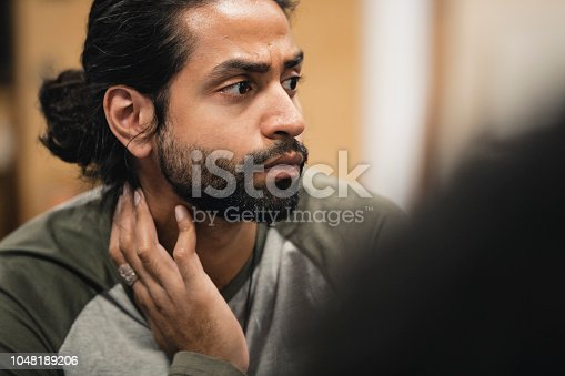 istock Listening Closely to Therapist in Support Group 1048189206