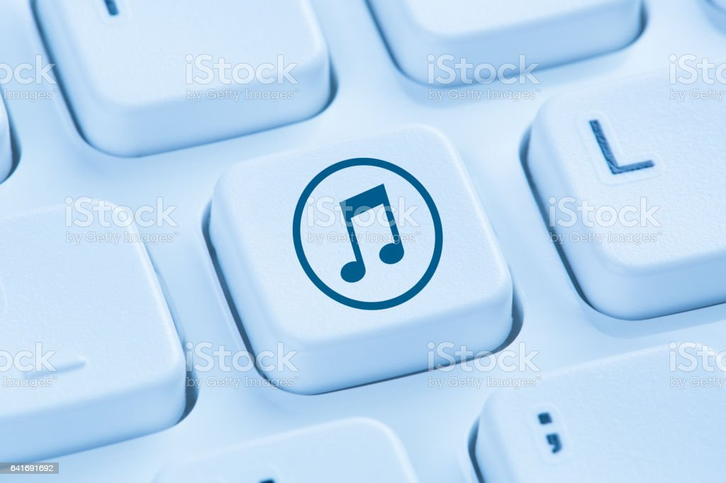 Listening download downloading streaming music internet blue computer keyboard stock photo