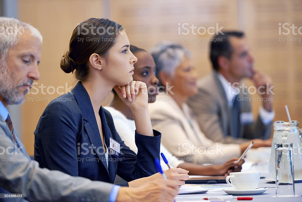 Listening intently stock photo