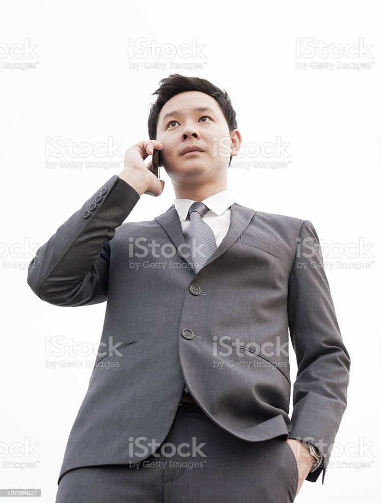 Listening intently to a colleague on mobile phone royalty-free stock photo