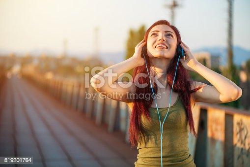 istock Listening music 819201764