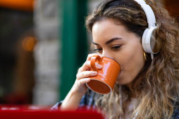 Listening music with headphones . stock photo