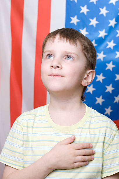 listening national anthem - national anthem stock photos and pictures