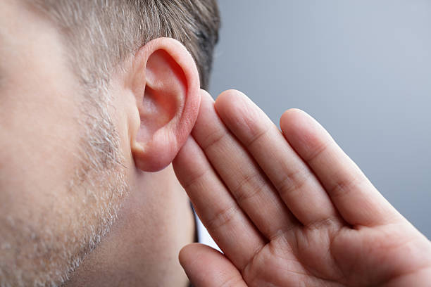 listening - sensory perception stock pictures, royalty-free photos & images