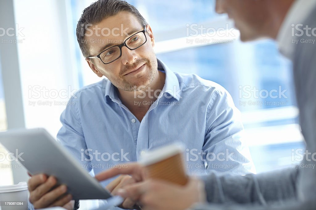 Listening to a colleague's corporate advice stock photo
