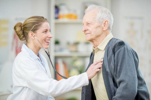 Listening To A Man's Heartbeat stock photo