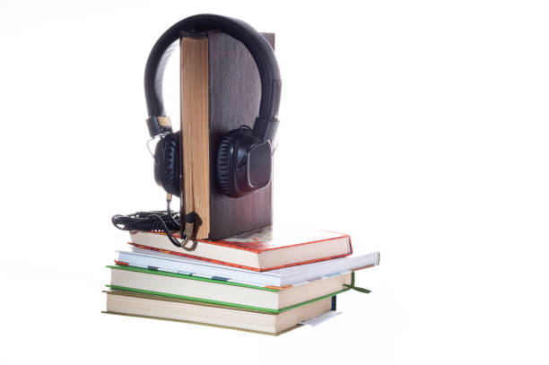 Listening to books through headphones. Listening to stories through books. Live book and headphones. Listening to books through headphones. Listening to stories through books. Live book and headphones. Isolate. antecedence stock pictures, royalty-free photos & images
