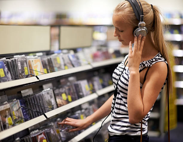 Listening to her bands' new single stock photo