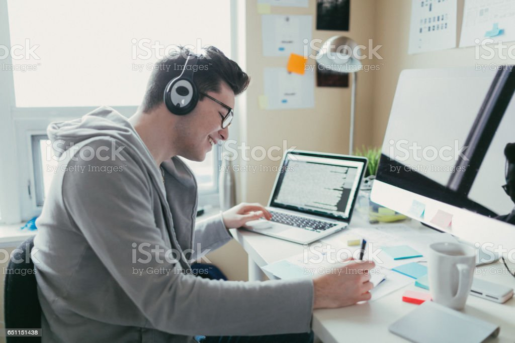 Listening to music and working stock photo