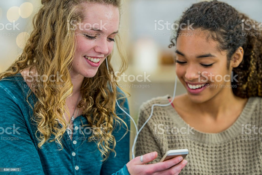 Listening to Music on a Cell Phone stock photo