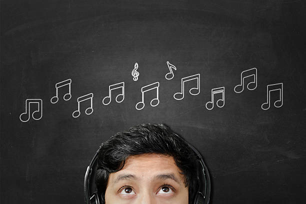 ouvir música - desenhos de notas musicais - fotografias e filmes do acervo