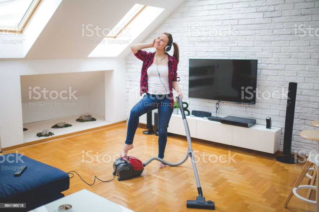 Listening to music while cleaning royalty-free stock photo