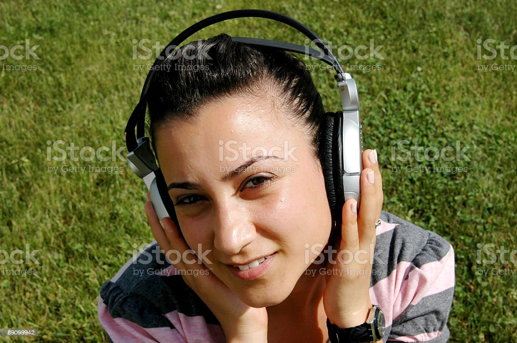 listening to music with headphone royalty-free stock photo