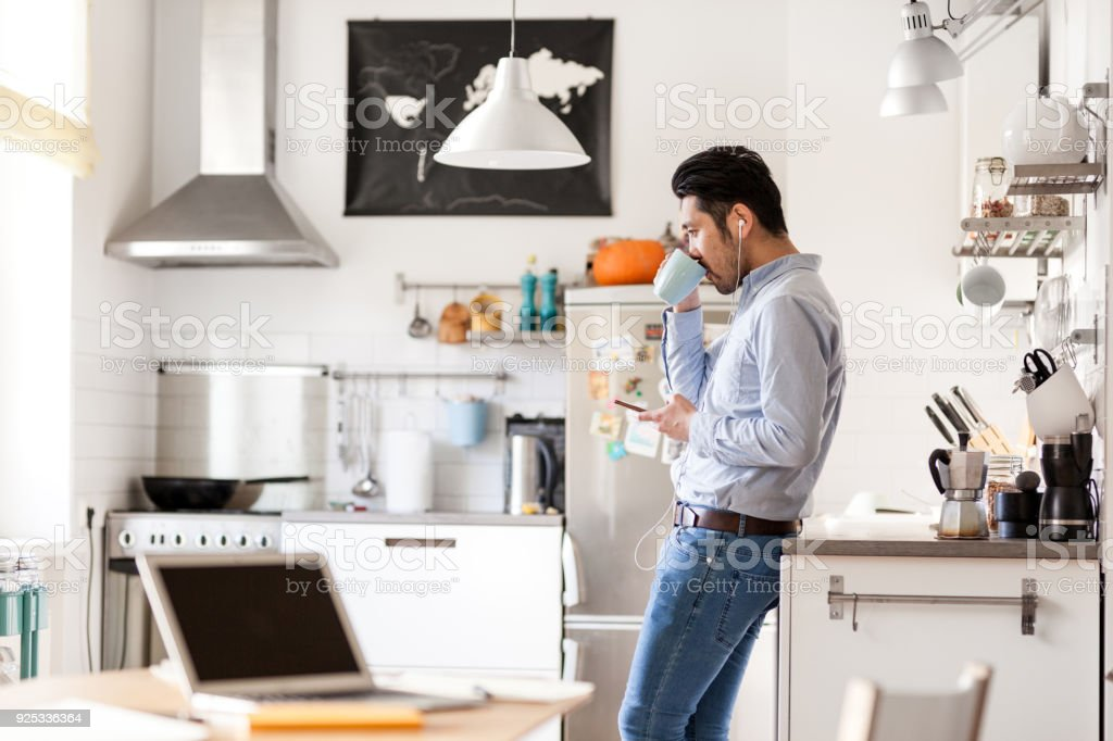 Listening to podcast and drinking coffee stock photo
