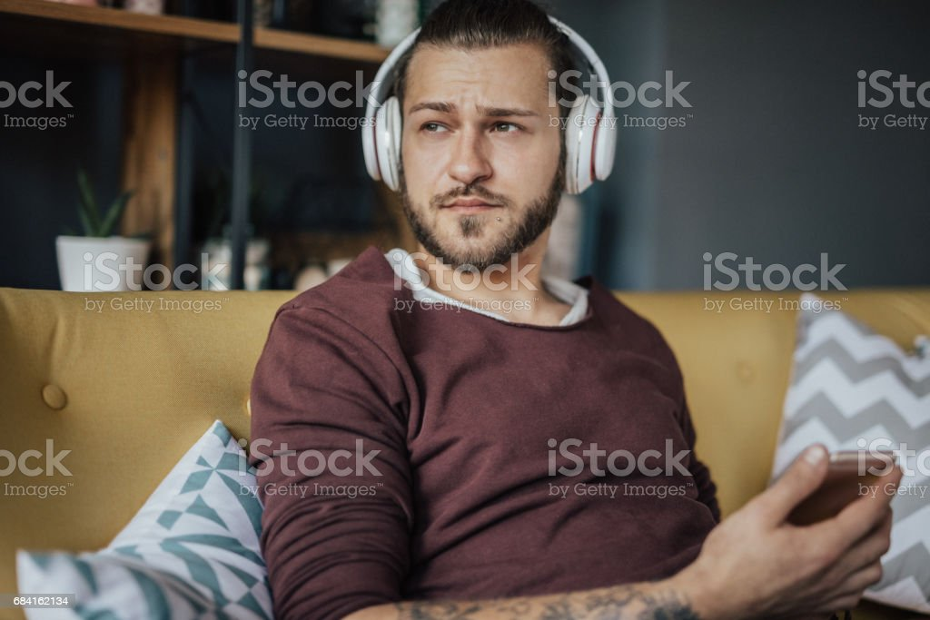 Listening to podcast, reading a book, listening to an aduibook and watching films isn't waste of time. It's how somebody becomes wise! royalty-free stock photo