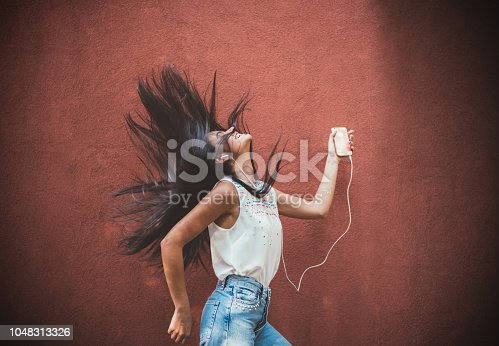 545098584 istock photo Listening to the music 1048313326
