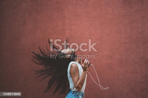 545098584 istock photo Listening to the music 1048313500