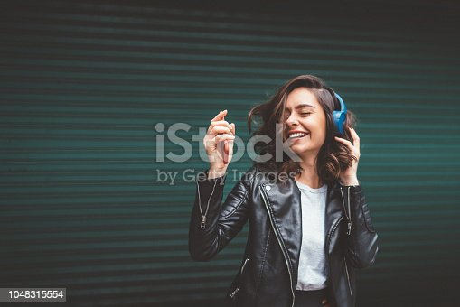 Young girl dancing to the music