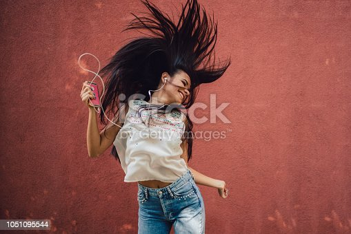 545098584 istock photo Listening to the music 1051095544