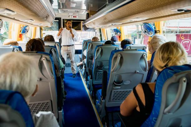 tourguide hören - tour bus stock-fotos und bilder