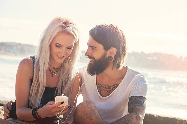 listening together to their favorite music - nose ring stock pictures, royalty-free photos & images