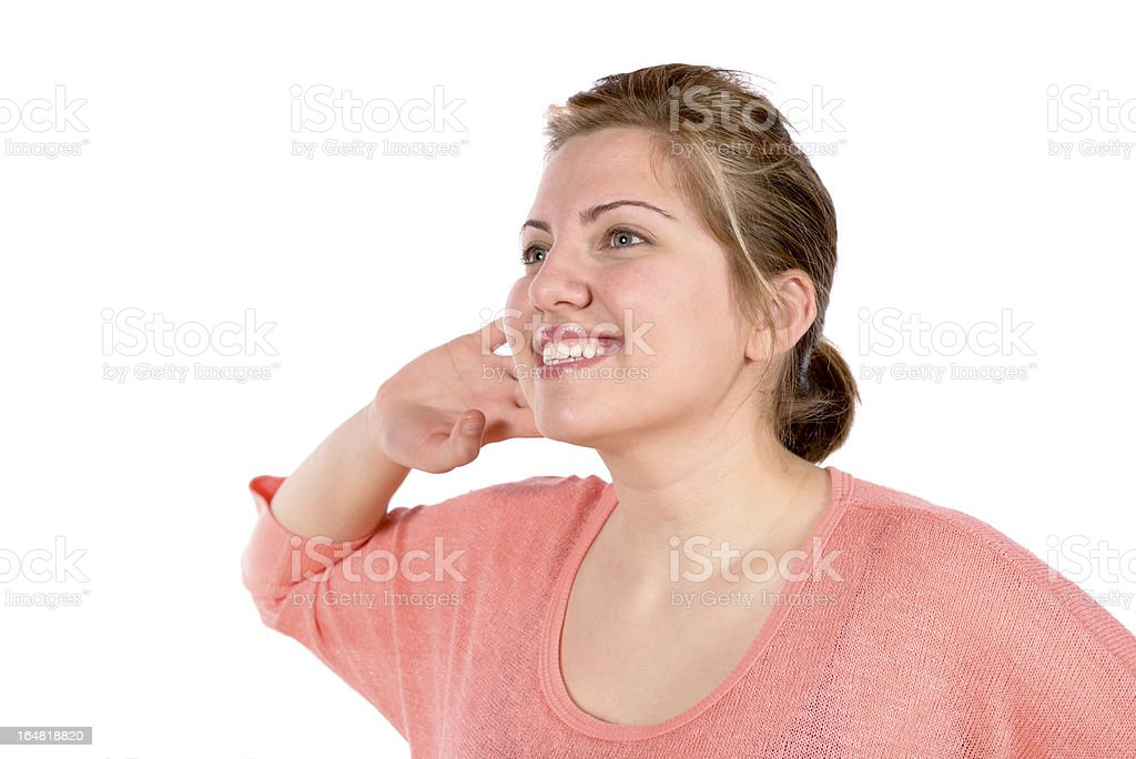 Listening woman with hand at ear royalty-free stock photo