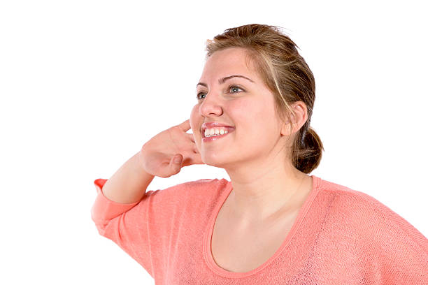 Listening woman with hand at ear stock photo