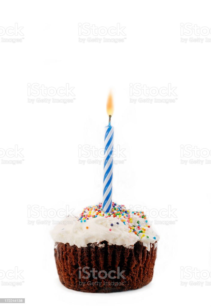 Lit candle sticking in a homemade cupcake royalty-free stock photo