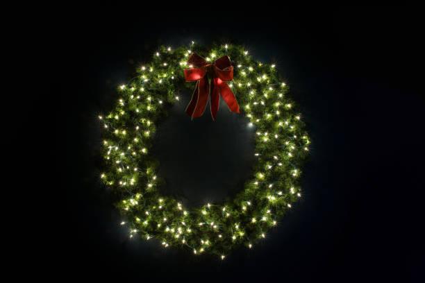 Lit Christmas Wreath on Navy Wall stock photo
