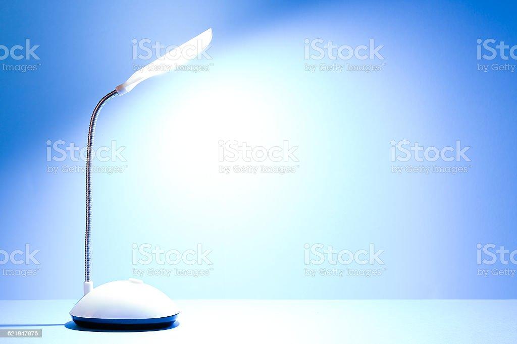 lit desk lamp stock photo