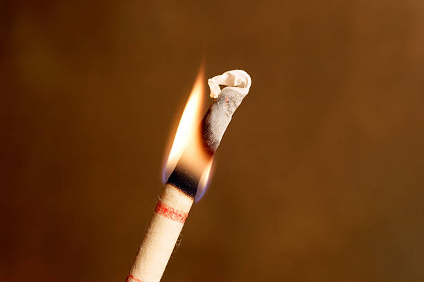 lit ear candle - hopi stock photos and pictures