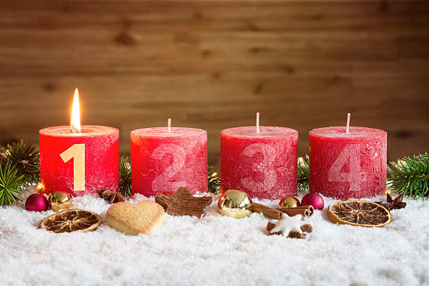 lit first advent candle in snow - julkalender bildbanksfoton och bilder