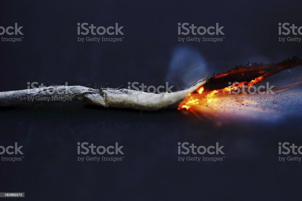 Lit fuse burning stock photo